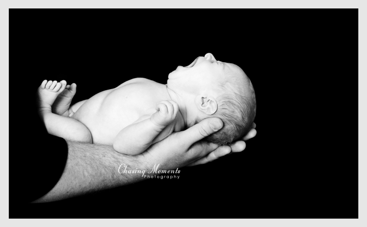 newborn baby in daddy