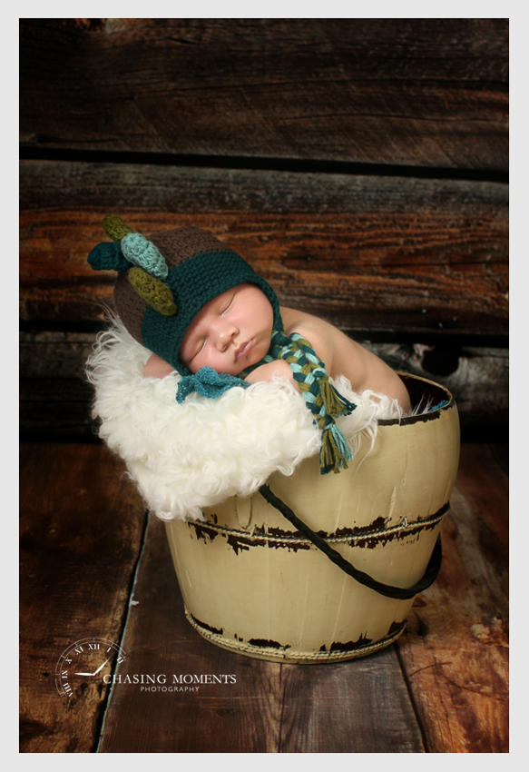 baby in bucket asleep
