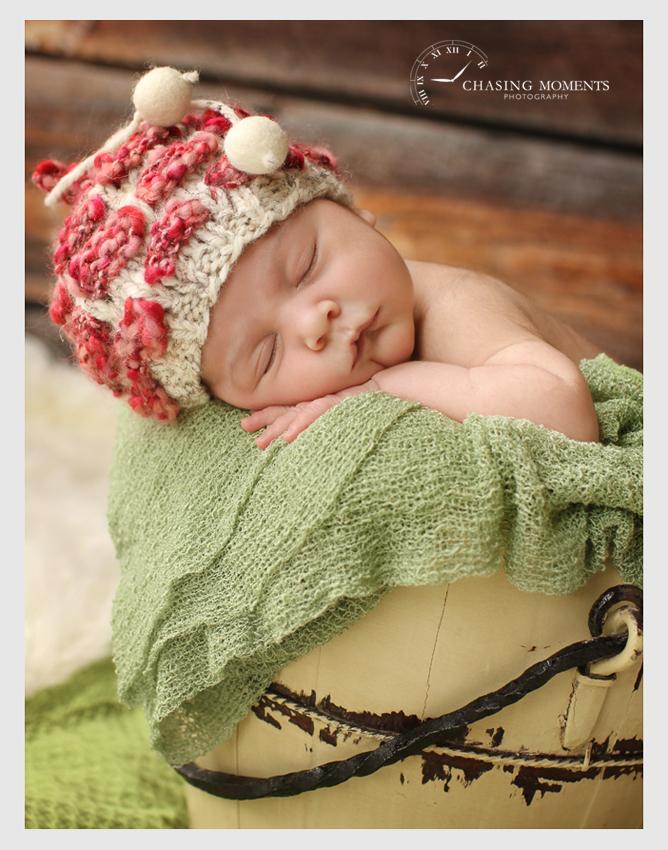 baby in christmas hat in bucket
