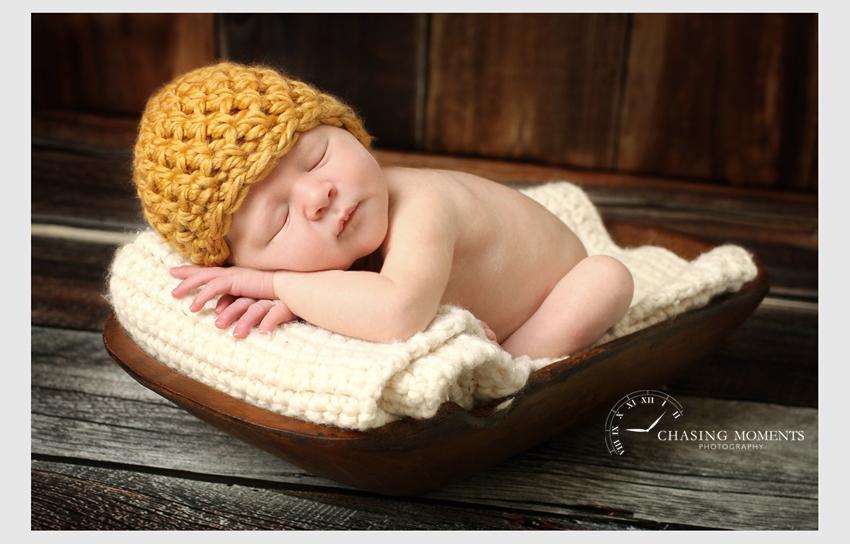 newborn asleep in a bowl