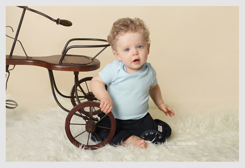 1 year old baby professional photography with antique bike