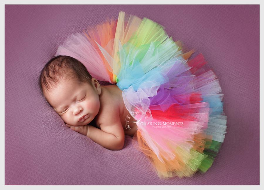 bright colorful tutu on newborn baby girl