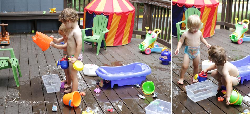 kids playing in water sprinkler on deck